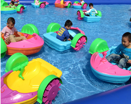 Kids hand paddle boat in the pool